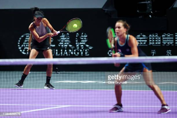 SuWei Hsieh of Chinese Taipei and Barbora Strycova of the Czech Republic return the ball against Gabriela Dabrowski of Canada and Xu Yifan of China...