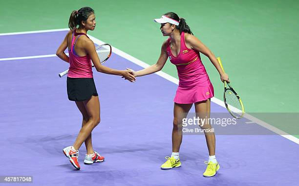 SuWei Hsieh of Chinese Taipei and Shuai Peng of China celebrate a point against Alla Kudryavtseva of Russia and Anastasia Rodionova of Australia in...