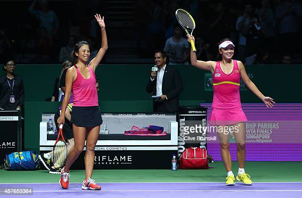 SuWei Hsieh of Chinese Taipei and Shuai Peng of China wave to the crowd after their two set victory against Garbine Muguruza and Carla Suarez Navarro...