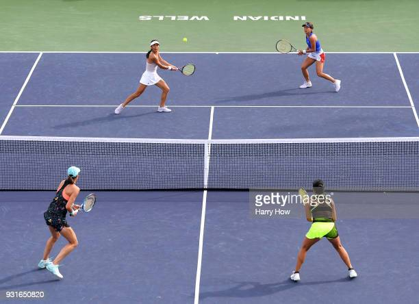 SuWei Hsieh of Chinese Taipei plays a volley with Barbora Strycova of the Czech Republic in their match against Vania King of the United States and...