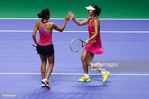 SuWei Hsieh of Taipei and Shuai Peng of China celebrate defeating Garbine Muguruza and Carla Suarez Navarro of Spain in the doubles quarter finals...