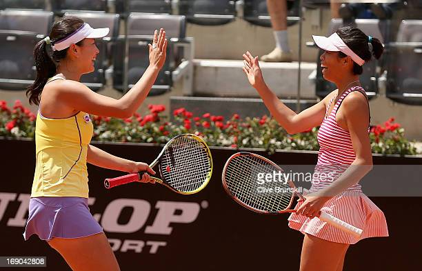SuWei Hsieh of Taipei and Shuai Peng of China celebrate match point against Sara Errani and Roberta Vinci of Italy in their doubles final match...