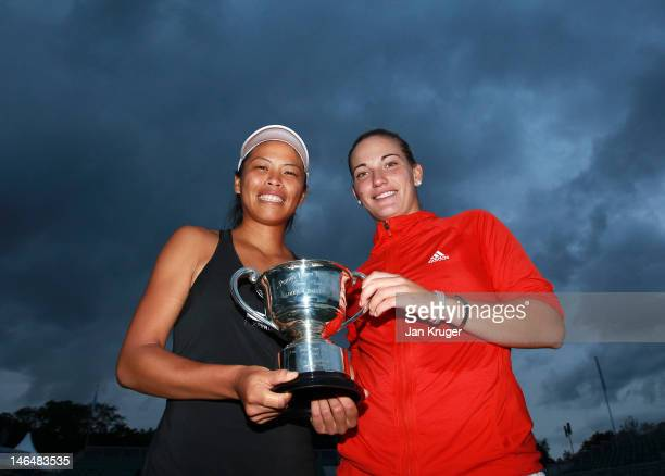 Su-Wei Hsieh of Taipei and Timea Babos of Hungary pose with the trophy after winning the Women's doubles match against Lisa Raymond and Liezel Huber...