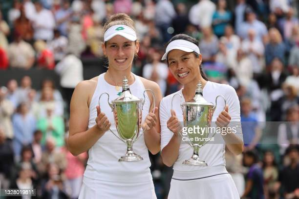Su-Wei Hsieh of Taiwan and Elise Mertens of Belgium celebrate with their trophies after winning their Ladies' Doubles Final match against Veronika...
