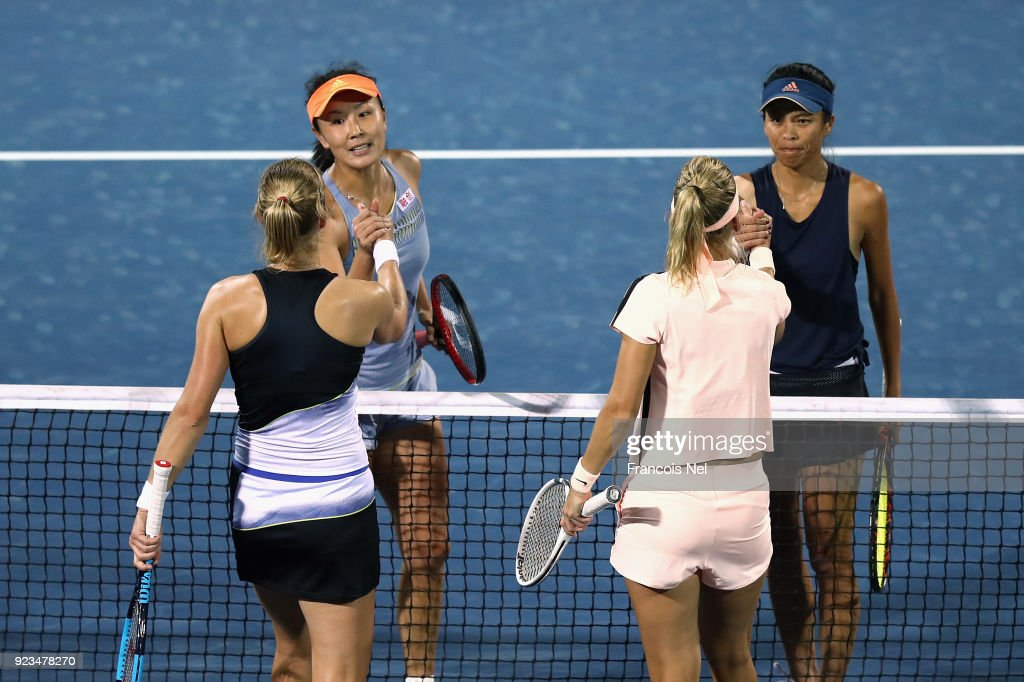 Su-Wei Hsieh of Taiwan and Shuai Peng of China is congratulated by Ekaterina Makarova of Russia and Elena Vesnina of Russia after the womens's doubles semi final match in her semi final match on day five of the WTA Dubai Duty Free Tennis Championship at the Dubai Tennis Stadium on February 23, 2018 in Dubai, United Arab Emirates.