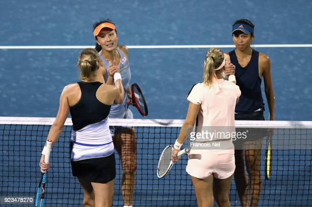 SuWei Hsieh of Taiwan and Shuai Peng of China is congratulated by Ekaterina Makarova of Russia and Elena Vesnina of Russia after the womens's doubles...