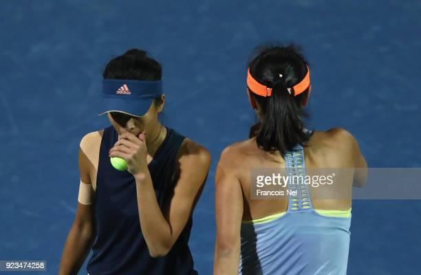 SuWei Hsieh of Taiwan and Shuai Peng of China talk tactics in the women's doubles semi final match against Ekaterina Makarova of Russia and Elena...