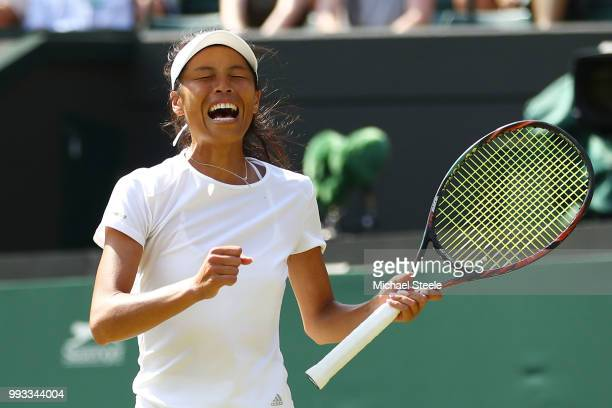SuWei Hsieh of Taiwan celebrates winning match point against Simona Halep of Romania during their Ladies' Singles third round match on day six of the...