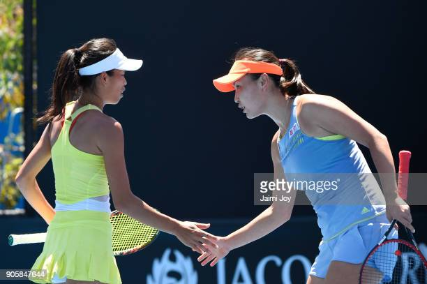 SuWei Hsieh of Tapei and Shuai Peng of China talk tactics in their first round doubles match against Mihaela Buzarnescu of Romania and Maria Irigoyen...
