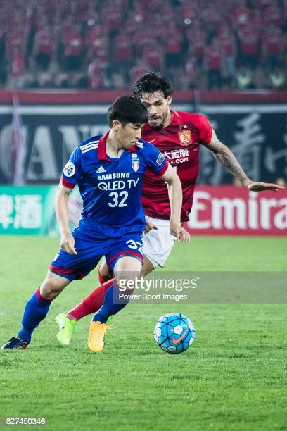 Suwon Defender Jang Hoik fights for the ball with Guangzhou Forward Ricardo Goulart during the AFC Champions League 2017 Group G match between...