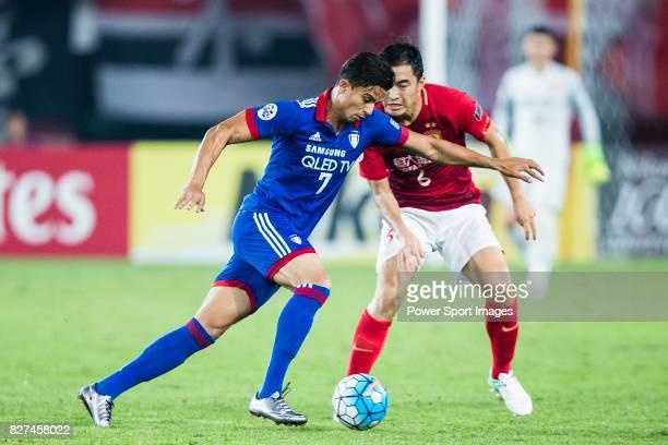 Suwon Forward Johnathan Da Silva Vilela plays against Guangzhou Defender Feng Xiaoting during the AFC Champions League 2017 Group G match between...
