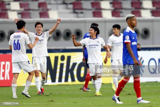 Suwon players celebrate winning during the AFC Champions League Round of 16 match between Yokohama F.Marinos and Suwon Samsung Bluewings at the...