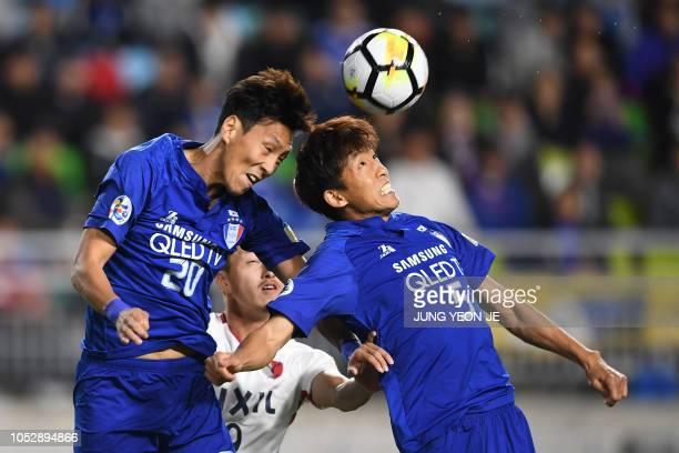 Suwon Samsung Bluewings' Kwak Kwangsun and Jo Sungjin head the ball during the AFC Champions League semifinal football match between South Korea's...
