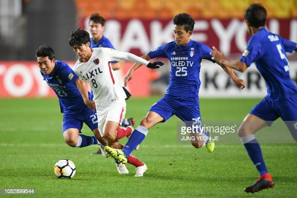 Suwon Samsung Bluewings' Lee Kije and Kashima Antlers' Shoma Doi compete for the ball during the AFC Champions League semifinal football match...