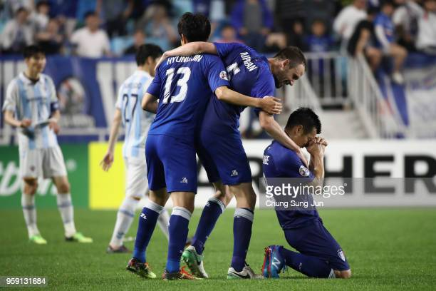 Suwon Samsung Bluewings players celebrate their 3-0 victory in the AFC Champions League Round of 16 second leg match between Suwon Samsung Bluewings...