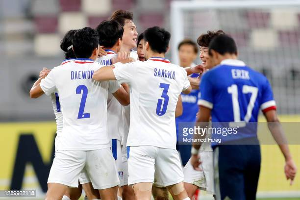 Suwon's players celebrate their third goal during the AFC Champions League Round of 16 match between Yokohama F.Marinos and Suwon Samsung Bluewings...