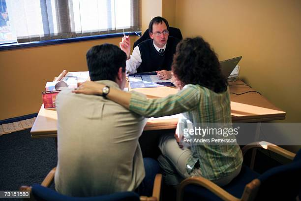 Suz Redfern and her husband Marty are consulted in the office of Dr. Paul Le Roux on May 29, 2006 at the Cape Town fertility clinic in Cape Town...