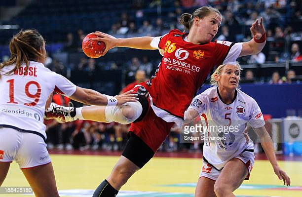 Suzana Lazovic of Montenegro jump to score past Linn Gosse and Ida Alstad of Norway during the Women's European Handball Championship 2012 gold medal...