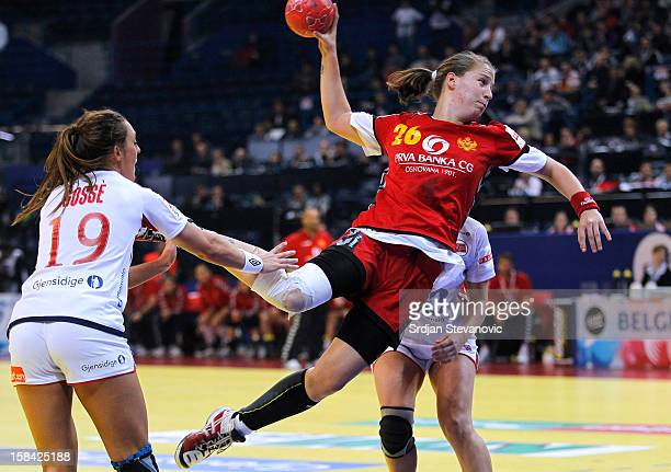Suzana Lazovic of Montenegro jump to score past Linn Gosse of Norway during the Women's European Handball Championship 2012 gold medal match between...