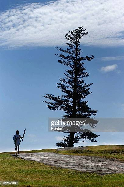 Suzane Evans a swimmer who represented Norfolk Islands in the South Pacific Games 1993 runs along the Lone Pines Area as the Queen's Baton during the...