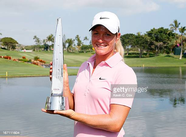 Suzann Petersen of Norway poses with the trophy after winning the LPGA LOTTE Championship Presented by J Golf at the Ko Olina Golf Club on April 20...