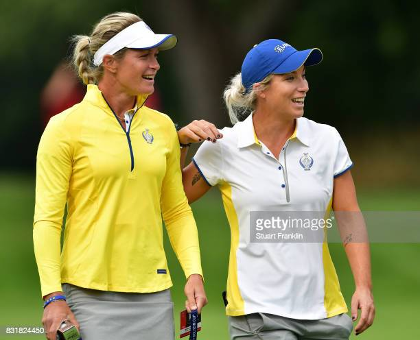 Suzann Pettersen and Melissa Reid of Team Europe share a joke during practice for The Solheim Cup at the Des Moines Country Club on August 15 2017 in...