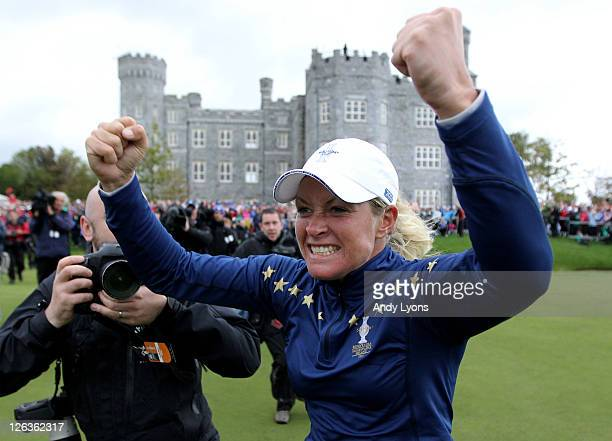 Suzann Pettersen of Europe celebrates her team's 1513 victory on the 18th green during the singles matches on day three of the 2011 Solheim Cup at...