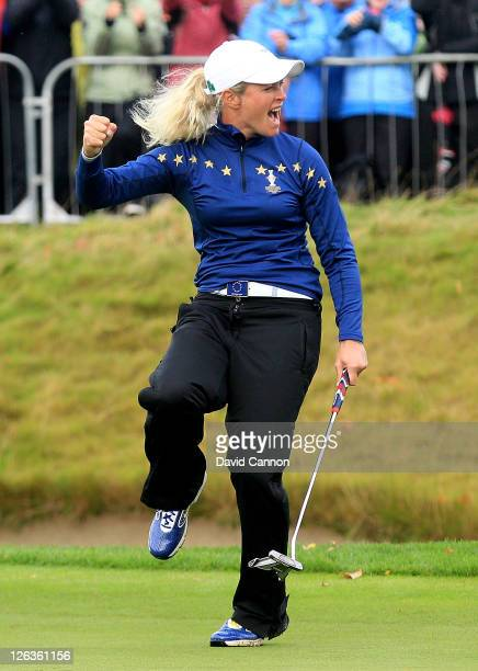 Suzann Pettersen of Europe celebrates holing a putt on the 15th green during the singles matches on day three of the 2011 Solheim Cup at Killeen...