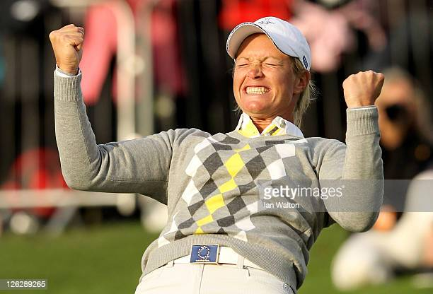 Suzann Pettersen of Europe celebrates holing a putt on the 16th green during the afternoon fourballs on day two of the 2011 Solheim Cup at Killeen...