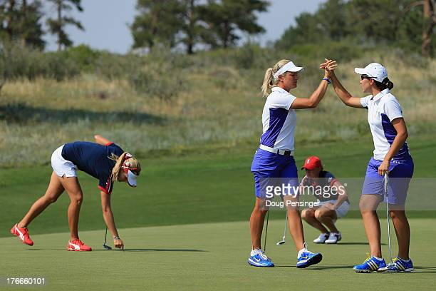 Suzann Pettersen of Norway and Carlota Ciganda of Spain and the European Team celebrate on the 10th green as they went on to defeat Stacy Lewis and...