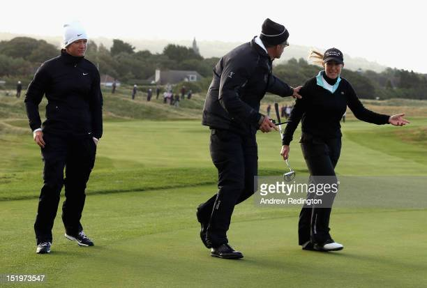 Suzann Pettersen of Norway and Cristie Kerr of the USA indcate to LPGA Rules Official Jim Haley how balls were moving in high winds on the 12th green...
