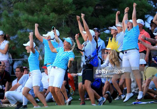 Suzann Pettersen of Norway Caroline Hedwall of Sweden and the European Team celebrate as Karine Icher clinched the final match on the 18th green...
