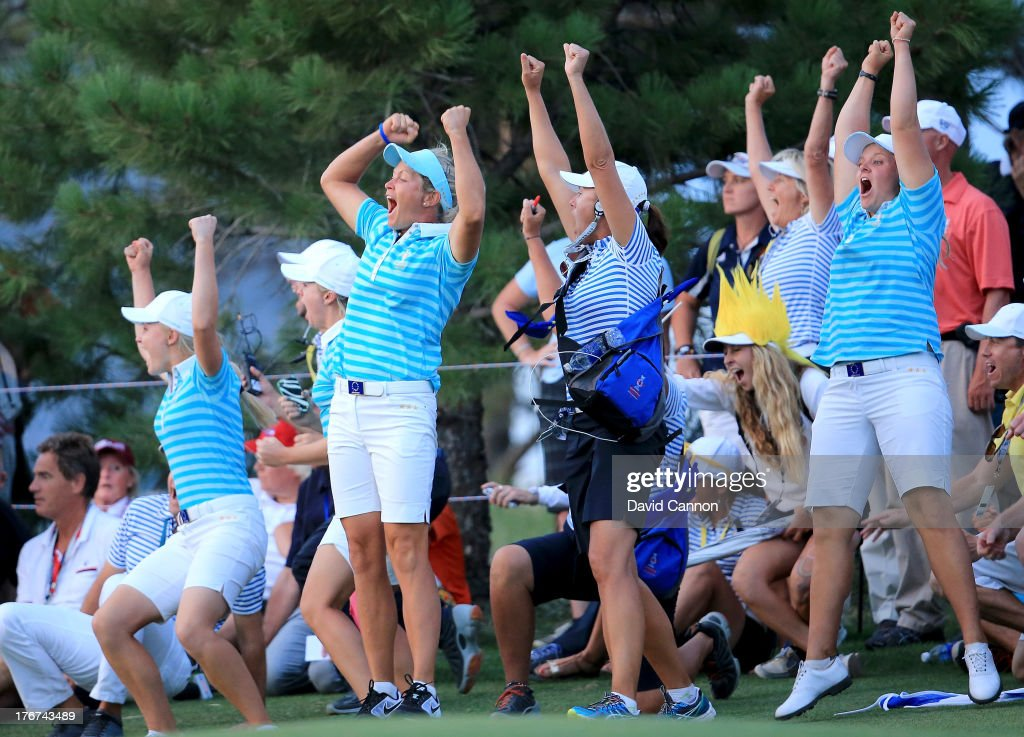 Suzann Pettersen of Norway, Caroline Hedwall of Sweden (R) and the European Team celebrate as Karine Icher clinched the final match on the 18th green during the afternoon fourball matches for the 2013 Solheim Cup at The Colorado Golf Club on August 17, 2013 in Parker, Colorado.