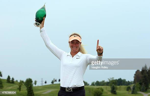 Suzann Pettersen of Norway celebrates with the champions trophy after winning the Manulife LPGA Classic at the Whistle Bear Golf Club on June 7 2015...