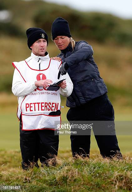 Suzann Pettersen of Norway discusses a shot with her caddie on the 7th hole during the Ricoh Women's British Open Golf ProAm day at the Royal...
