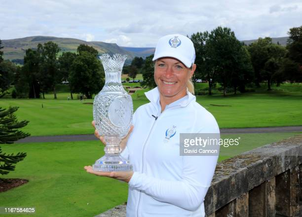 Suzann Pettersen of Norway holds the Solheim Cup beside the Gleneagles Hotel during the European Solheim Cup Team announcement at Gleneagles on...