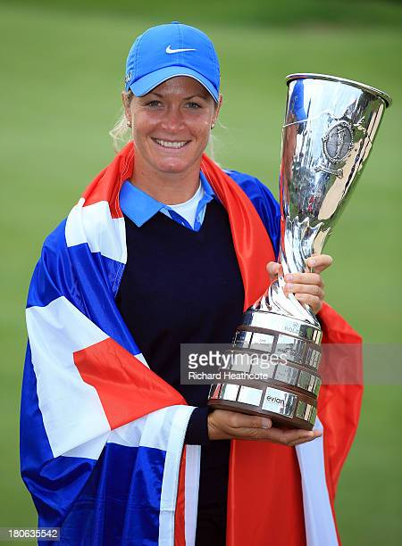Suzann Pettersen of Norway holds the trophy after securing victory in the third round of The Evian Championship at the Evian Resort Golf Club on...