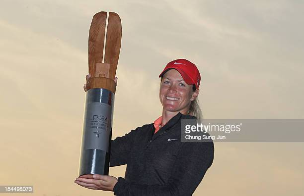 Suzann Pettersen of Norway lifts the winners trophy during a ceremony following the KEBHanaBank Championship at Sky 72 Golf Club Ocean Course on...