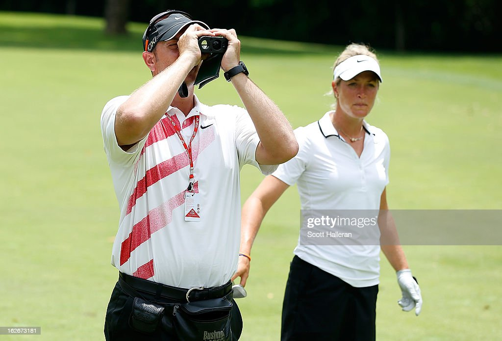 Suzann Pettersen of Norway waits alongside her caddie Brian Dilley during a practice round prior to the start of the HSBC Women's Champions at the Sentosa Golf Club on February 26, 2013 in Singapore, Singapore.