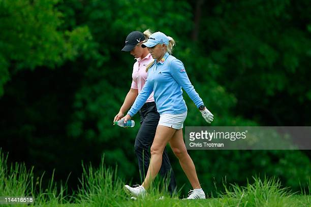 Suzann Pettersen of Norway walks down the sixth fairway with her opponent Natalie Gulibis during round one of the Sybase Match Play Championship at...