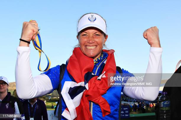 Suzann Pettersen of Team Europe celebrates her team winning the Solheim Cup during the final day singles matches of the Solheim Cup at Gleneagles on...