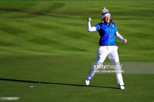 Suzann Pettersen of Team Europe celebrates her winning putt on the eighteenth hole in her match with Marina Alex of Team USA during the final day...