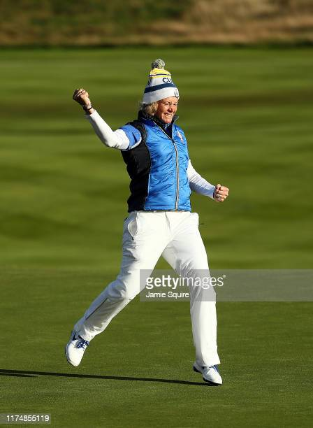 Suzann Pettersen of Team Europe celebrates making her final putt on the 18th hole as Europe wins the Solheim Cup during the final day singles matches...
