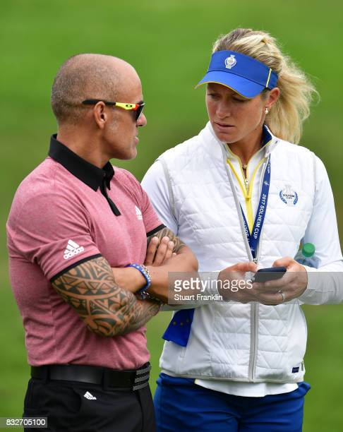 Suzann Pettersen of Team Europe talks with her personnal trainer during practice for The Solheim Cup at the Des Moines Country Club on August 16 2017...