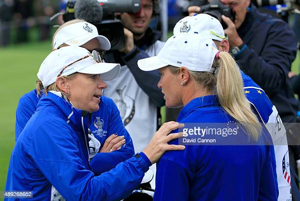 Suzann Pettersen of the European team in deep discussion with her vicecaptain Annika Sorenstam about the length of putt that she did not concede to...