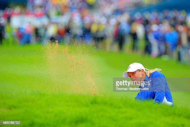 Suzann Pettersen of the European Team shots her second ball at the first hole during the Sundays single matches in the 2015 Solheim Cup at St LeonRot...