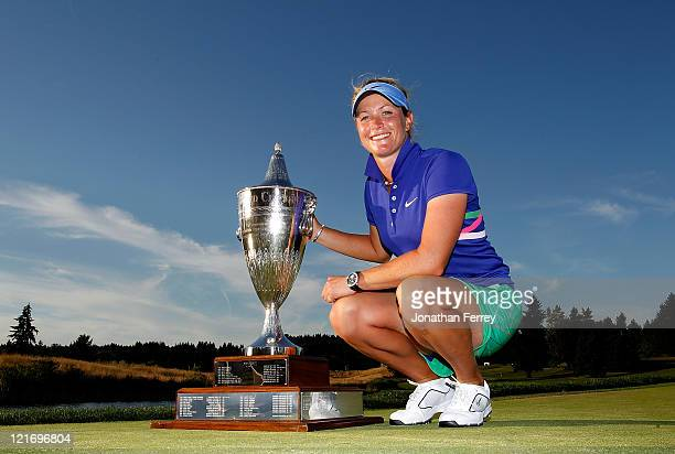Suzann Pettersen poses with the trophy after winning in a playoff against Na Yeon Choi on the 18th hole during the final round of Safeway Classic at...