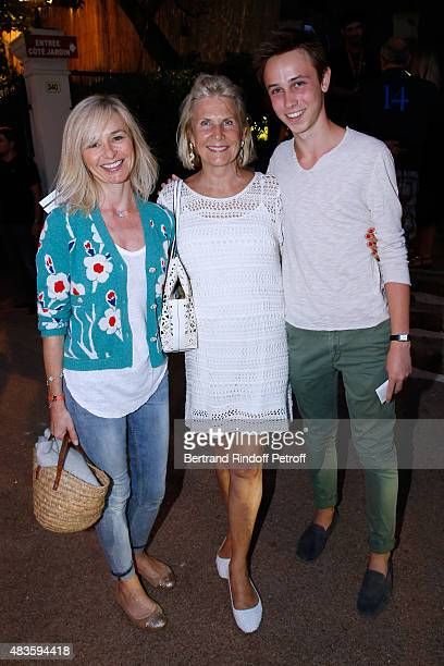 Suzanna Flammarion standing between actress Anais Jeanneret and her son Vincent Drucker attend the 'Fabrice Luchini Poesie ' show during the 31th...