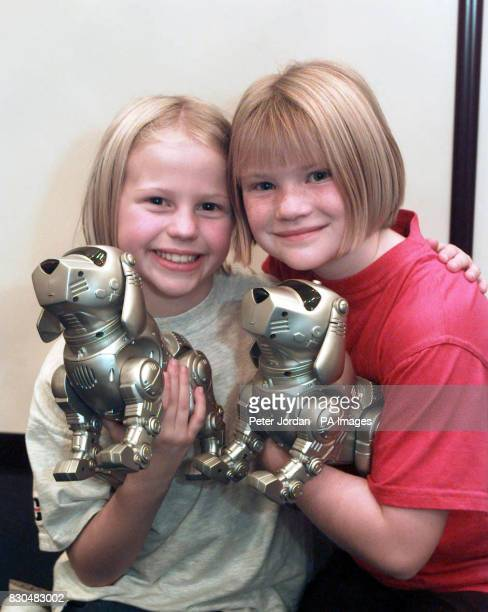 Suzanna Fredericks from Knowl Hill and Chloe Lyons from Kiln Green near Reading with Teksta robotic dogs at the toy fair in Earls Court London * The...