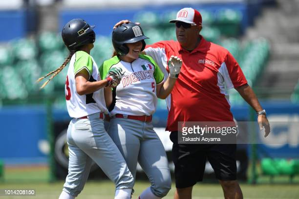 Suzannah Lillian Brookshire Gonzalez of Mexico celebrates with team mates after hitting the game winning RBI single in tiebreak against Italy during...